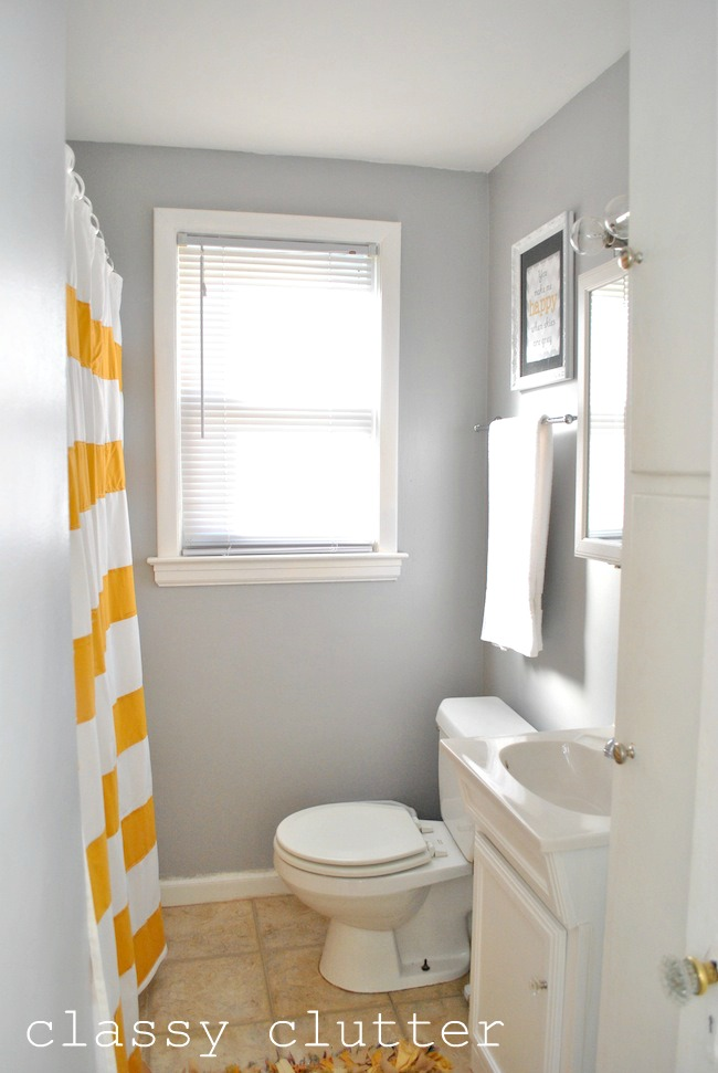 Clean and simple yellow bathroom redo classy clutter for Bathroom yellow paint
