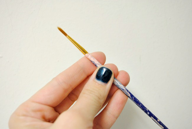 use a small craft paint brush