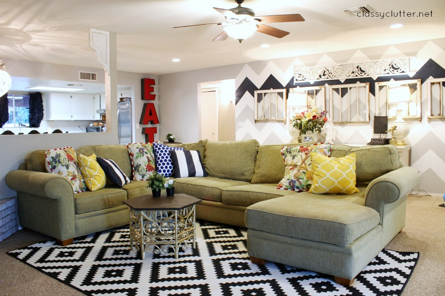 It is a large area rug and the price was right  only  99  I have been  loving the touches of black and white that I have put in almost every room. Cute and Colorful Living Room Reveal   Classy Clutter