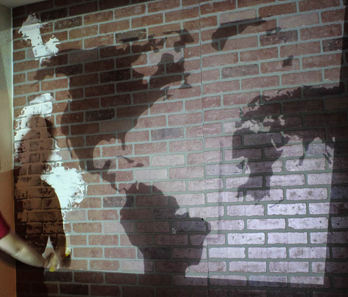 Diy faux brick wall indoor accent wall classy clutter shadow of world map to trace on brick accent wall gumiabroncs Gallery