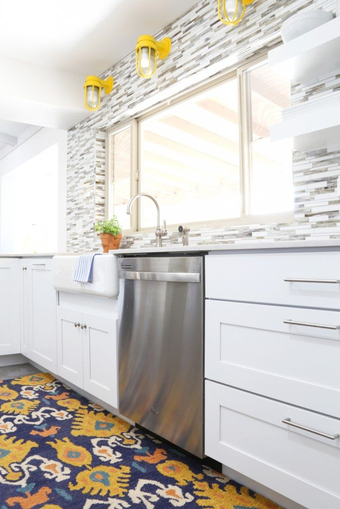 Urban Farmhouse Kitchen -- love the rug and lights