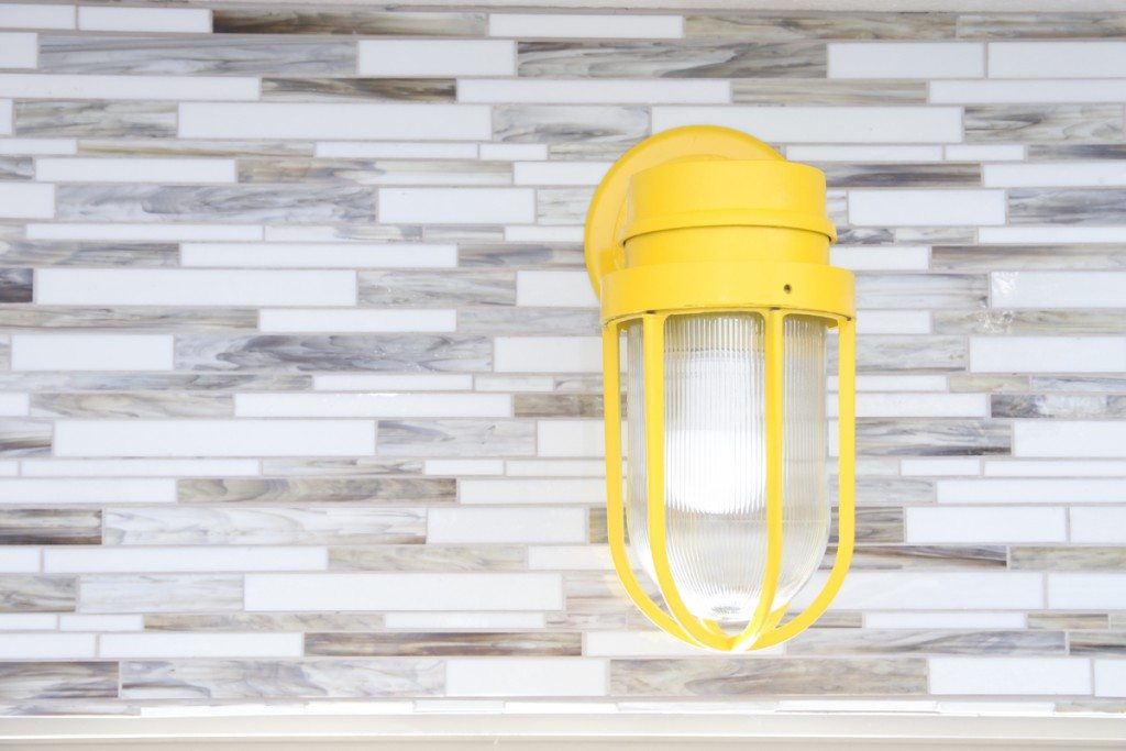 Love these cool vintage lights painted bright yellow