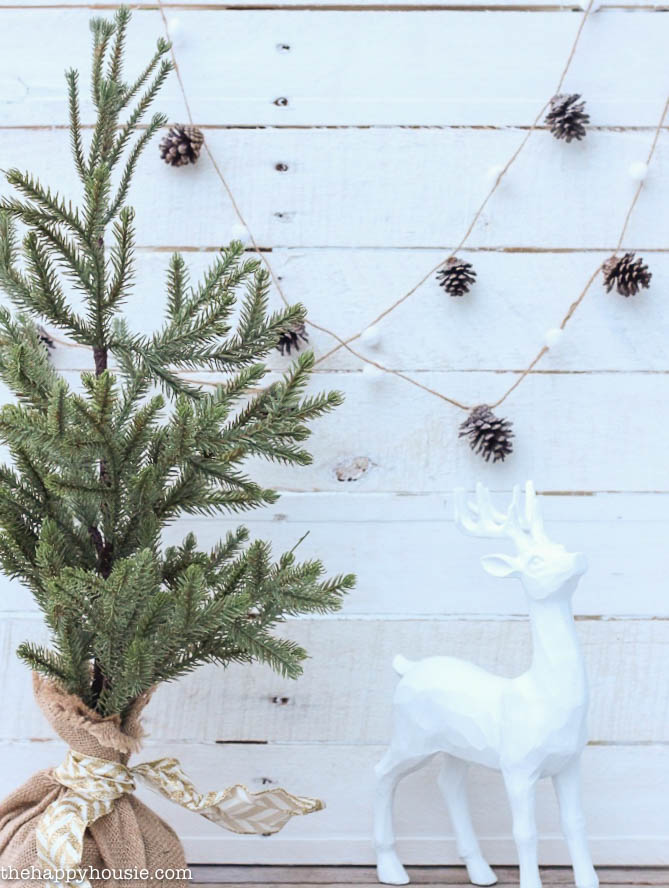 DIY-Pom-Pom-Pine-Cone-Garland-for-the-holidays-by-thehappyhousie.com-for-Classy-Clutter-5