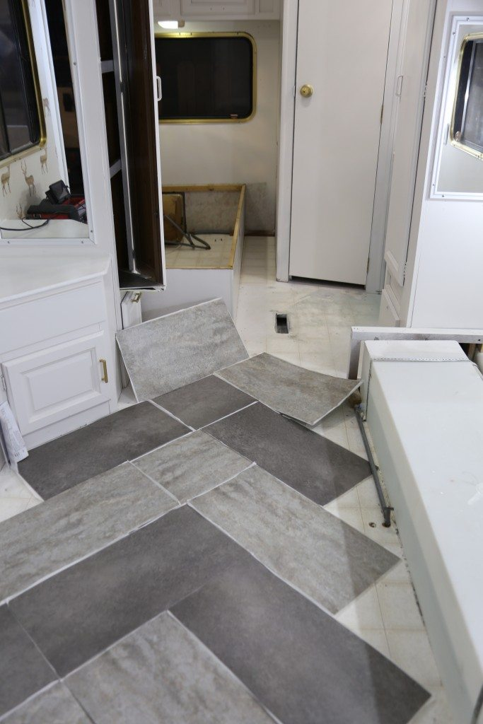 Trailer remodel with peel and stick vinyl flooring for Vinyl tile over linoleum