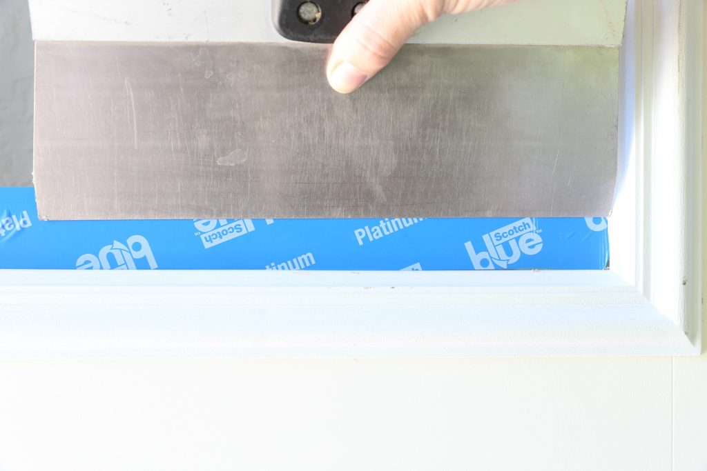 Smoothing Painters Tape On Front Door