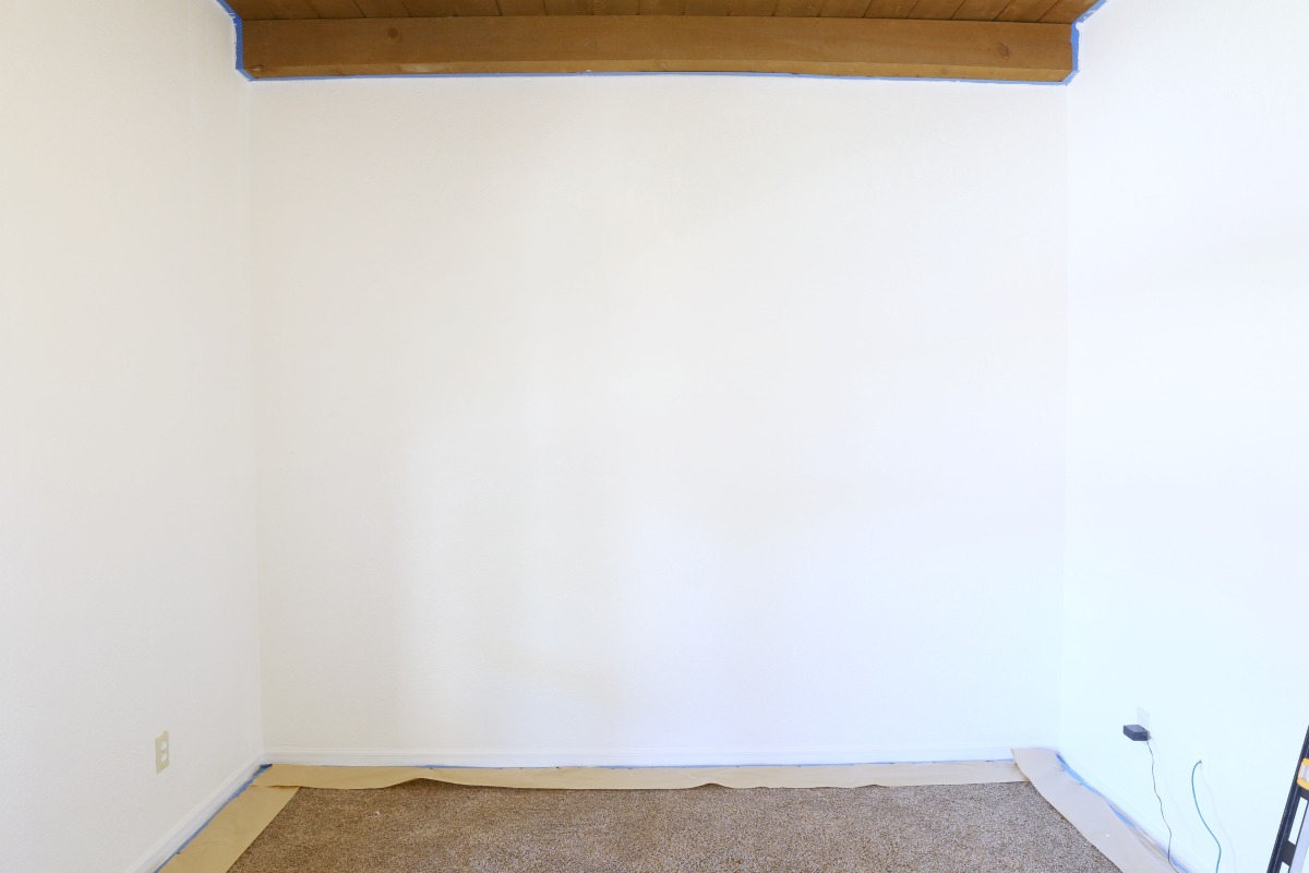 How to paint an asymmetrical striped wall! - Love this room makeover! www.classyclutter.net