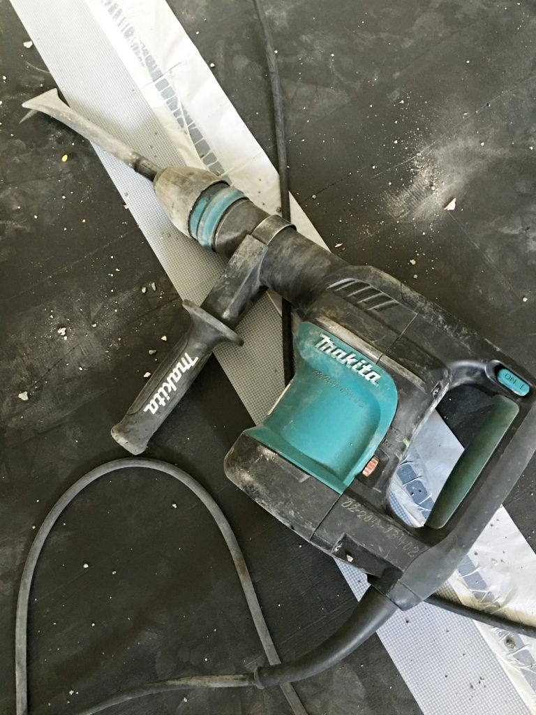 kitchen-renovation-remove-countertops-with-hamemer-drill