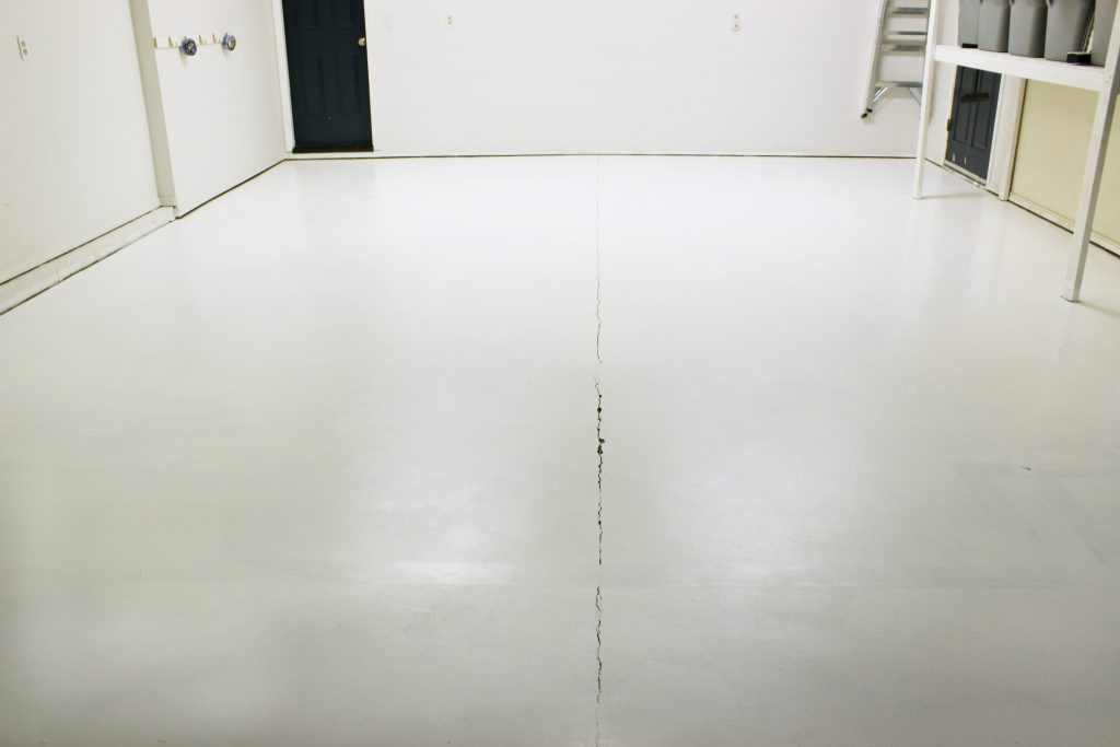 First coat of concrete floor paint