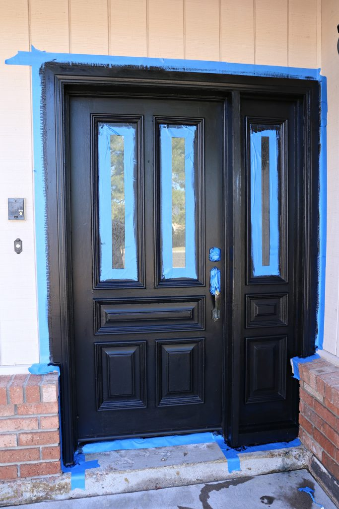 I taped around the whole door and the windows to make painting a bit easier Updating My Curb Appeal by Painting My Front Door   Classy Clutter. Paint Exterior Door Or Trim First. Home Design Ideas
