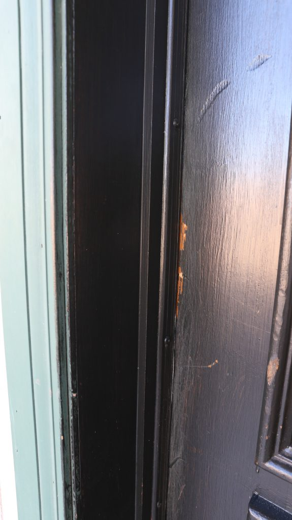 Who ever painted the door in the first place did not do that great of a  job  There was a lot of wood showing through the black paint Updating My Curb Appeal by Painting My Front Door   Classy Clutter. Paint Exterior Door Or Trim First. Home Design Ideas