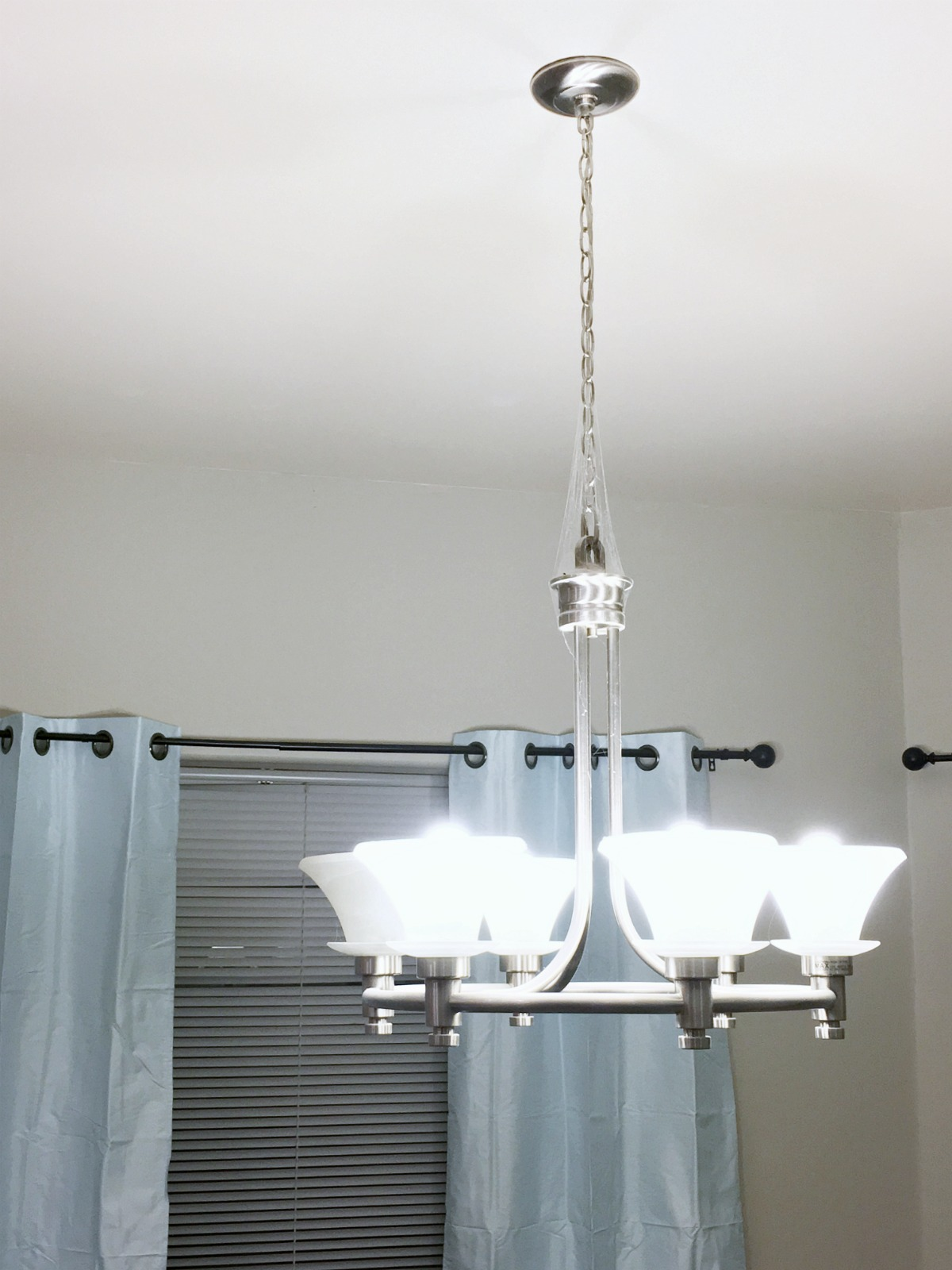 Home improvement how to update a light fixture classy for Updating bathroom light fixtures