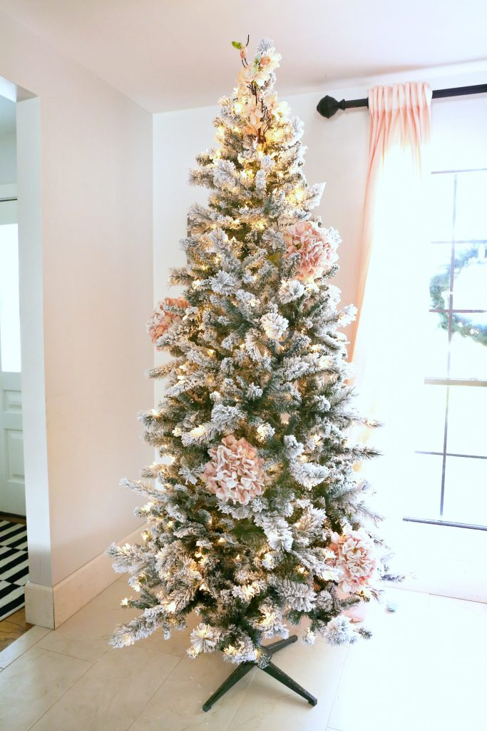 How to Trim out a Flocked Christmas Tree with Pink Accents