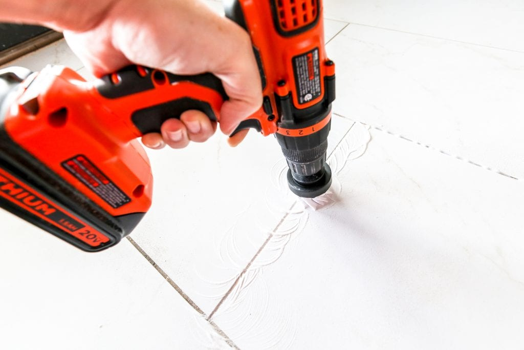 How to clean grout with a drill